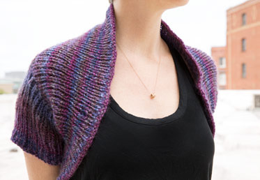 Come join Maggie Pace in this online knitting class with this shrug garment making project.  This sweater is knit all in one piece so there is no seaming and the back is knit from side to side with distinctive color yarn gradation.