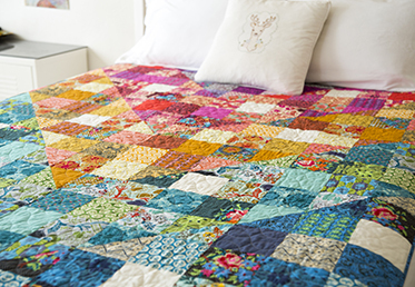 This is a perfect class for combining scraps of fabric. Anna Maria Horner begins by walking quilters through the process of sorting their fabrics into color groups, she demonstrates how to cut and piece the squares and half-square triangles