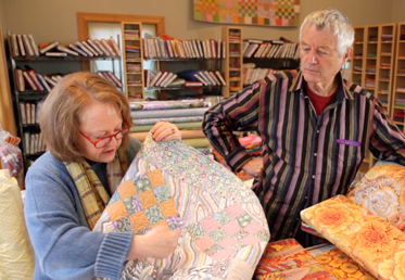 Kaffe Fassett and Liza work together to create a masterful medallion quilt in rich, warm tones. The quilt begins with a stunning medallion center that is comprised of English paper-pieced hexagon rings and hand-appliqued fussy-cut fabrics.