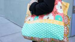 Joel Dewberry and Laurie combine their love of colorful fabric with sewing know-how to make a stunning and sturdy farmer's market tote bag. Both the interior and exterior of the bag are pieced together with eye-catching fabrics.
