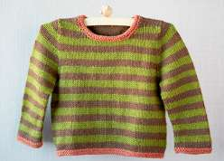 Gudrun Johnston teaches you to make this adorable striped toddler sweater knitting project. This is a seamless quick knit sweater with a striped or solid yarn color with a contrasting hem and cuff, worked up in worsted weight yarn.