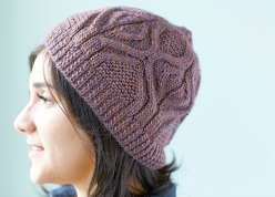 Designer Norah Gaughan shows you how to make this gloriously textured cabled hat.  You'll learn to work with worsted weight yarn, as the hat is made with a ribbed cable cast on, repeating cable pattern, and sinuous curves.