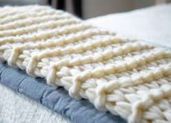 In this knitting lesson you'll learn to make this great throw blanket!