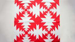 Red and white quilts are stunning, especially when they're made with pineapple blocks