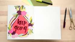 Learn how to make a mixed media collage in your sketchbook. Pam Garrison will also show you how to do hand lettering using brush-tip markers.
